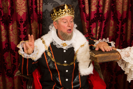 swearing: Royal king swearing a solemn oath at his inauguration