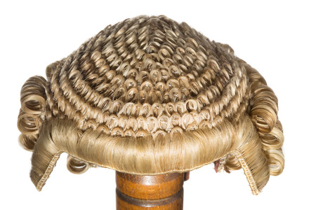 Isolated front view on an authentic horsehair judge wig