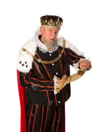 Senior king making an announcement holding a parchment scroll Standard-Bild