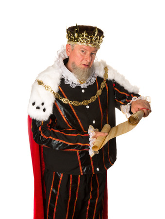 Senior king making an announcement holding a parchment scroll Stockfoto