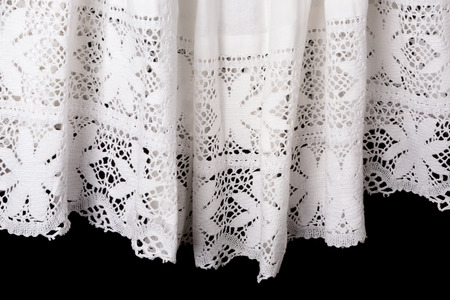 vestment: Isolated view on the lace edge of a catholic priest surplice