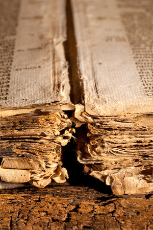 tattered: Closeup of the loose tattered pages of a 300 years old gothic book