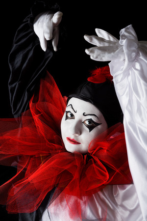 pierrot: Mime actress in Pierrot costume performing a dance