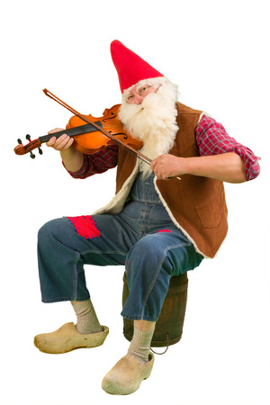 gnome: Funny garden gnome playing on a violin Stock Photo