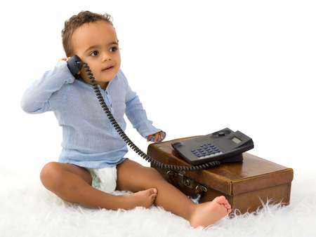 18 month old: Adorable little 18 month old toddler boy of African decent playing with a telephone Stock Photo