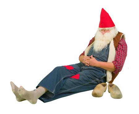 nain de jardin: Dr�le nain de jardin de coucher avec des trous dans ses chaussettes Banque d'images
