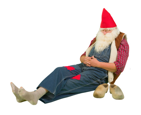 garden gnome: Funny sleeping garden gnome with holes in his socks