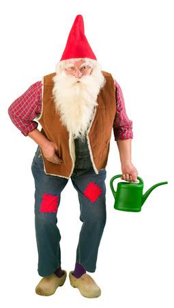 garden gnome: Funny garden gnome holding a miniature watering can Stock Photo