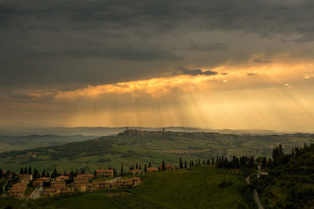 monticchiello: Town of Monticchiello in Tuscany Italy during a rainstorm at sunset