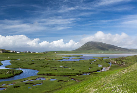 seawater: Ceapabhal hill and tital inlets or saltings at An Taobh Tuath or Northton on the Isle of Harris, Scotland.