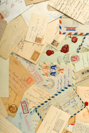 old letters: Old letters and envelopes spread out over a table