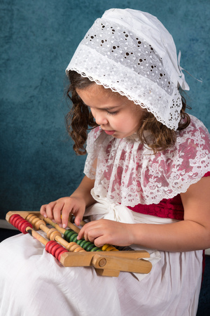 victorian girl: Sweet victorian girl posing in the old style with an abacus