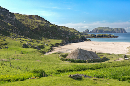 croft: Ancient blackhouse or celtic croft preserved and restorend on a beach on Lewis in the Ouder Hebrides of Scotland