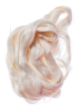 unprocessed: White silk tops in their raw unprocessed form Stock Photo