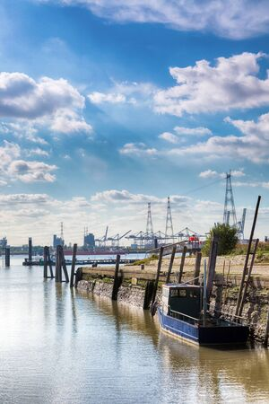 contrast: View on the busy port of Antwerp, seen from the little old port of Lillo village