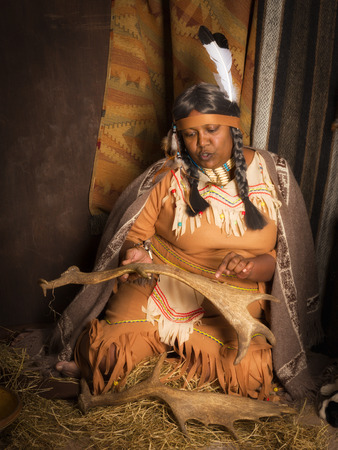sioux: Weathered mature tribal female storyteller talking about heroic times