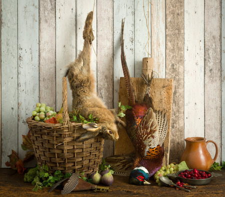 Antique old master hunting still life with pheasant and hare Standard-Bild