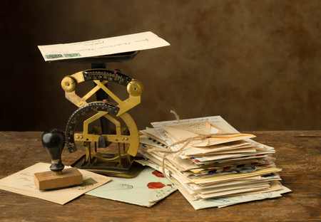 bundle of letters: Antique letter scale on an old wooden table with a bundle of letters Stock Photo