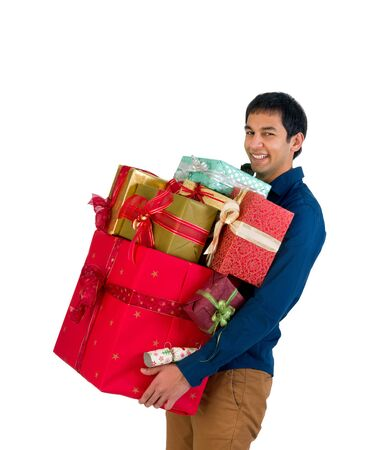 too many: Happy young man holding too many Christmas presents Stock Photo