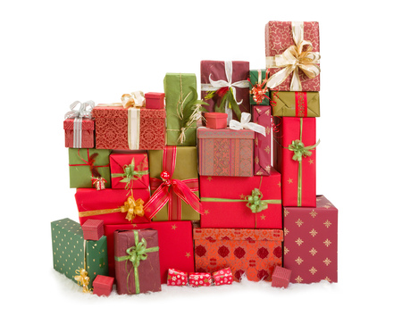 Beautiful stack of christmas presents with ribbons and bows