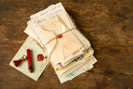envelopes: Wax seal next to a bundle of old letters on an antique wooden table Stock Photo
