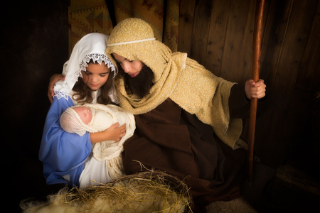 beautiful mother: Christmas nativity scene reenacted by children and a doll Stock Photo