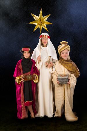 wisemen: Wisemen played by three girls in a live Christmas nativity scene