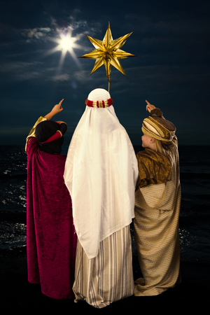 religious holiday: Wisemen played by three girls in a live Christmas nativity scene