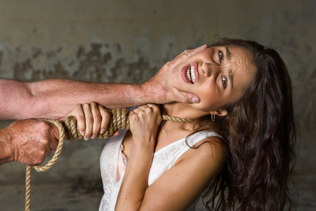 intimidation: Young woman being abused trying to defend herself Stock Photo