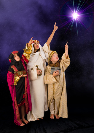 played: Wisemen played by three girls in a live Christmas nativity scene