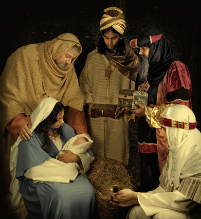 Mother Mary: Live Christmas nativity scene reenacted in a medieval barn Stock Photo