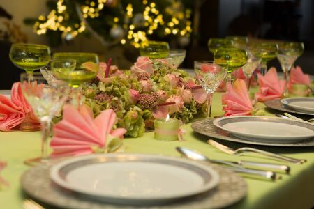 pink christmas: Festive Christmas table in soft pastel colors pink and green Stock Photo
