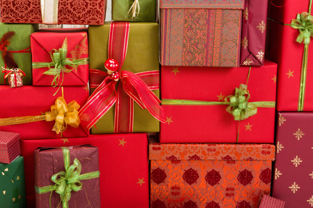 christmas gold: Full frame of christmas presents, can be used as a backdrop