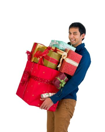 Happy young man holding too many Christmas presents photo