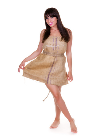 burlap sack: Funny photo of a young woman with nothing to wear but waste materials - this is part of a series with jute bag, toilet paper  Stock Photo