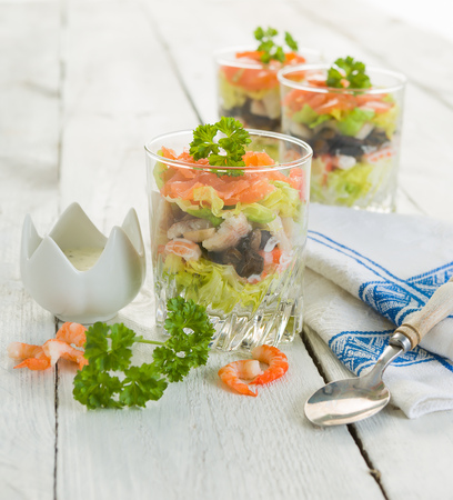 gastronomy: Seafood verrines with smoked salmon, shrimps, eel and salad Stock Photo