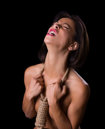hysterics: Beautiful woman with noose around her neck screaming out despair
