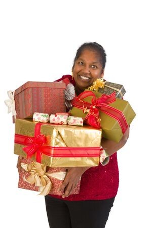 too many: Smiling mature woman holding too many christmas presents