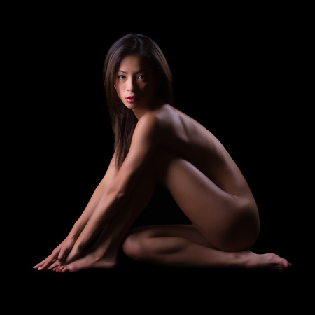 adult nudity: Implied nudity fine art image of a woman isolated on black