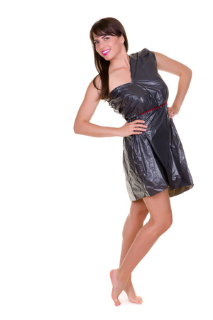 trash the dress: Funny photo of a young woman with nothing to wear but waste materials - this is part of a series with jute bag, toilet paper, bubble wrap etc Stock Photo