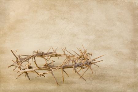 Crown of thorns lying on brown grunge wallpaper