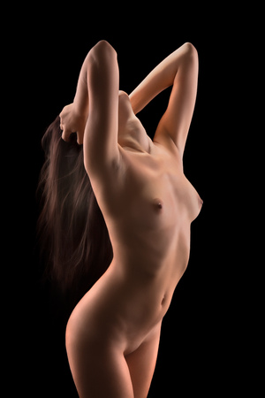 Fine Art Nude image of a young woman with very long hair