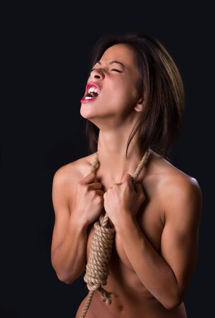 noose: Beautiful woman with noose around her neck screaming out despair
