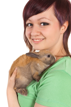 Happy teenager girl with her brown bunny rabbit photo