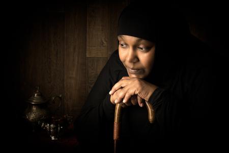 veiled: African mulsim woman weiring a black veil