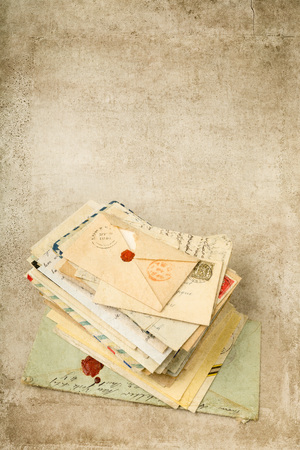 old letters: Grungy textured background with antique old letters Stock Photo