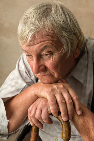 lonely: Lonely old man in nursing home leaning on his cane Stock Photo