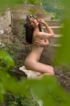 nude nature: Fairy or nymph woman posing outdoors in green surroundings