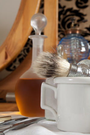 trimmers: Shaving brush and antique bottles in a victorian barbershop