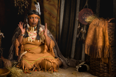 wise woman: Weathered mature tribal female storyteller talking about heroic times
